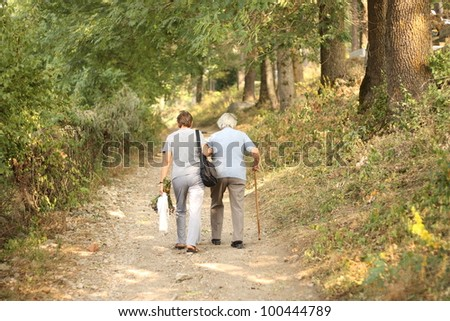 Seniors walking in park