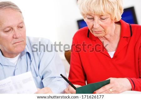 Seniors: Writing Checks For Monthly Bills