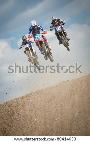 SENKVICE, SLOVAKIA - JUNE 26: F. Parrini #93 (ITA) M. Barquin #36 (BEL) and K. Braam #193 (NED) make a jump at the Motocross World Championship WMX race on June 26, 2011 in Senkvice, Slovakia