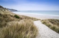 Sennen Cove beach and sand dunes before sunset Cornwall England