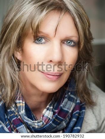 Sensitive mature lady looking relaxed at camera