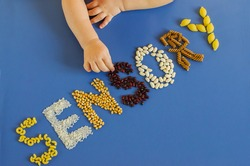 Sensory activities and play for toddler. Little hands playing with rice, popcorn, beans, pasta. Activities Montessori, games for sensory processing disorder, child development and occupational therapy