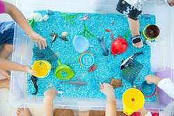 Sensory box with water color natural inside
