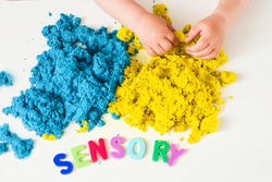 Sensory word and magic kinetic sand. Early sensory education. Kidd's sensory experiences, games and play for fine motor skills. Therapy hand, development of fine motor, autism, occupational therapy