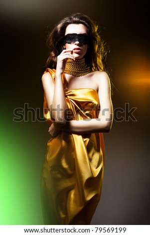 stock photo sensual adult woman in golden dress and black mask 79569199 Storyland in Fresno California