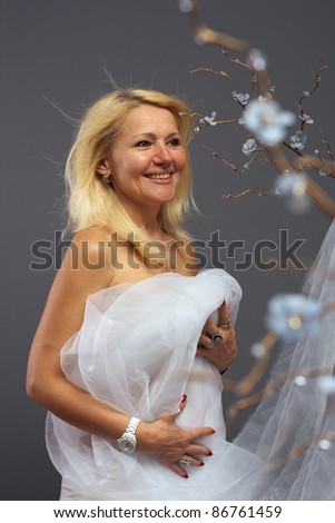 stock photo : sensual adult woman on mystic flower background wearing silver ...