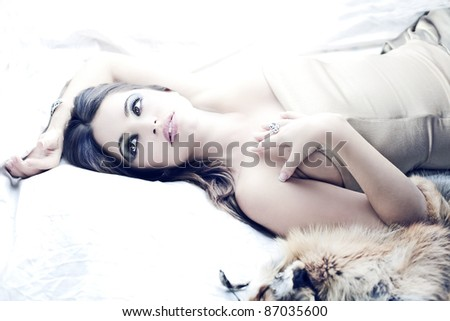 sensual beautiful brunette girl in bed