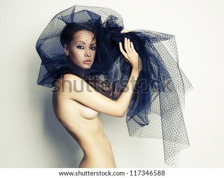 Sensual beautiful woman under the black veil