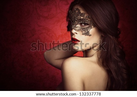 sensual beautiful young woman with lace mask, studio shot