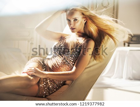 Sensual blonde beauty posing