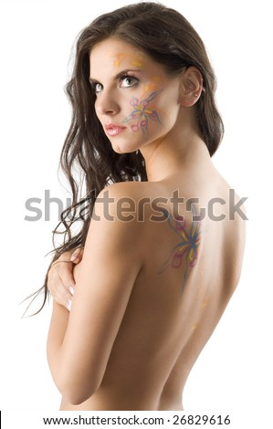 tattoo on her face. stock photo : sensual brunette with a flower tattoo on her face and on her
