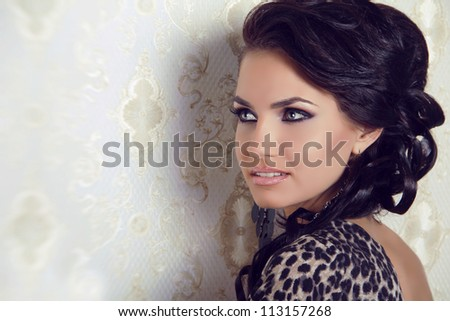 Sensual brunette woman with shiny curly silky hair