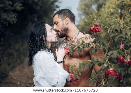 Sensual couple kiss. First love. Hugs together and sensual touch. Intimate relationship and sexual relations. Passionate lover caressing arousing beautiful woman. Woman with muscular latin lover #1187675728