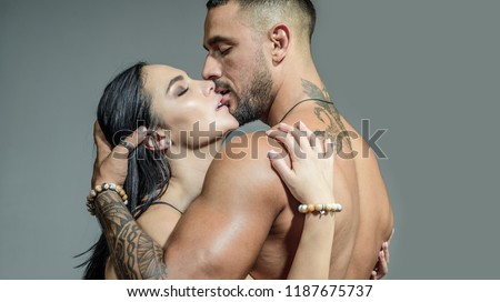 Sensual couple kiss. I Love You. Couple In Love. Romantic and love concept. Hugs together and sensual touch. Sexually explicit. Passionate lover caressing arousing beautiful woman. Dominant man #1187675737