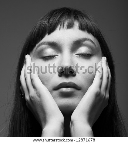 sensual dark portrait of a young woman with closed eyes - stock photo
