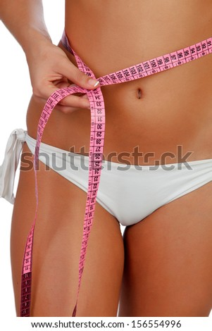 Sensual female body with bikini and tape measure isolated on a white background