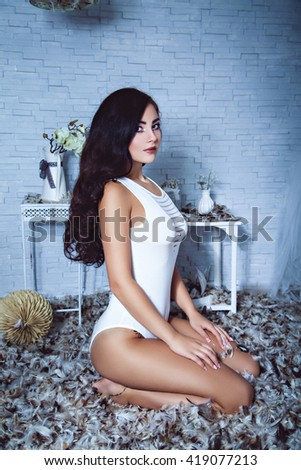 Sensual girl in feathers room #419077213