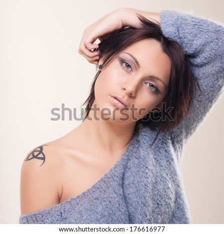 Stock Photo Sensual intimate young woman studio portrait.