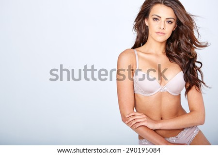 Sensual lady posing in  sexy lingerie while isolated