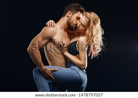 sensual man and woman having erotic games. close up photo. strong desire concept, isolated black background #1478797037
