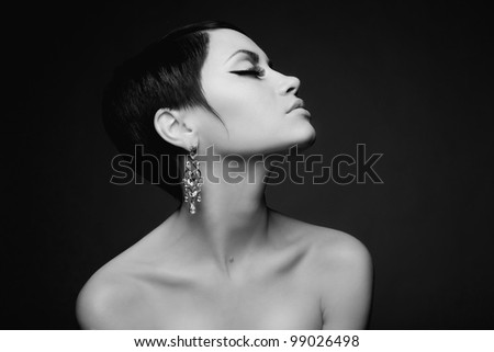 Sensual portrait of a beautiful lady with diamond earring