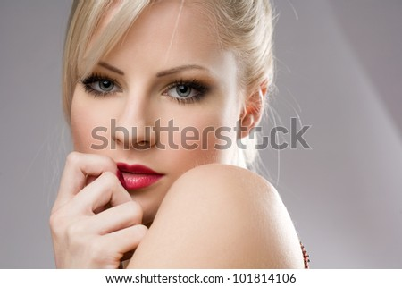 Sensual portrait of a gorgeous young blond woman.