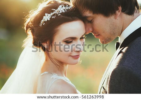 Sensual portrait of a young couple. Wedding photo outdoor #561263998