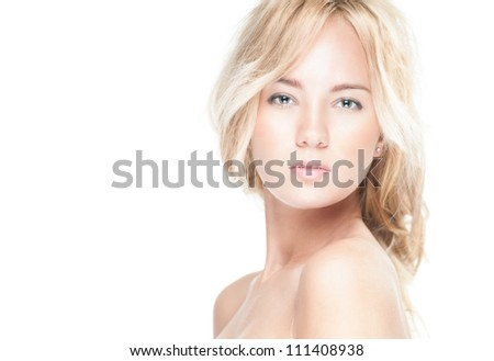 Sensual portrait of young beautiful blonde woman on white background. Sexy topless girl with curly hair looking passionate and tempting. Youth, pure natural beauty and passion.