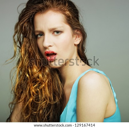 Sensual pretty woman with beautiful long blond curly  hairs