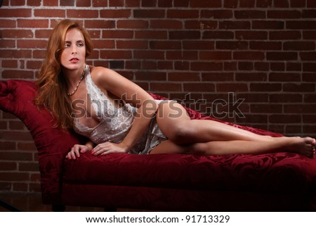 Sensual Red Head Woman Wearing Lingerie in Seductive Poses