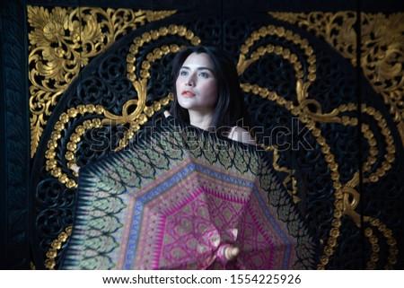 Sensual sexy nude Asian women sensuality standing behind umbrella.