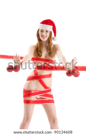Sensual sexy nude Caucasian woman Santa Claus in Christmas hat gift wrapped by red ribbon