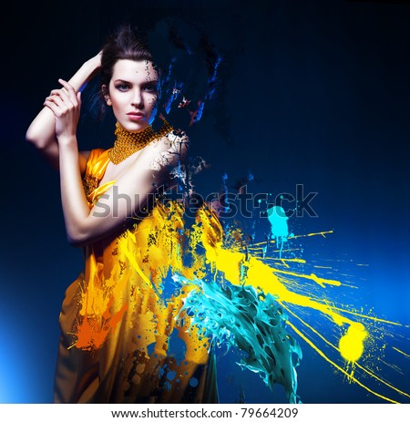 sensual sexy woman in long yellow dress and splatter