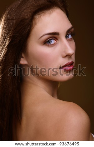 Sensual woman a face portrait looking over shoulder