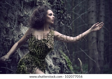 Sensual woman as a part of tree
