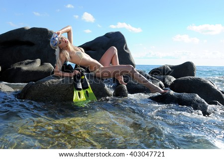 sensual woman in bikini with fins and diving mask #403047721