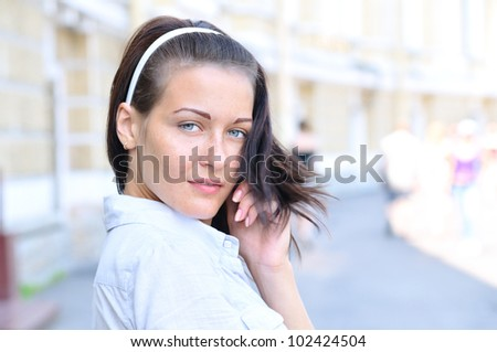 Sensual woman is looking back at sunny street