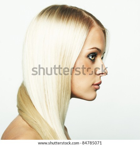 Sensual woman model with shiny straight long blond hair and  make-up