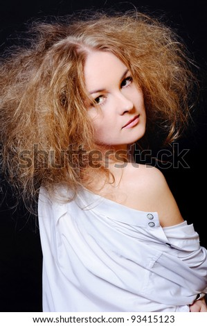 Sensual woman with fluffy hair.