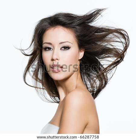 Sensual young adult woman with beautiful long brown hairs, posing isolated on white
