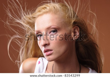 sensual young woman with beautiful long blond hair
