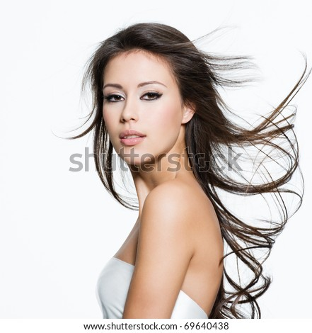 Sensual young woman with beautiful long brown hairs, posing isolated on white