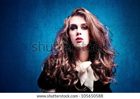 sensual young woman with curly hair studio shot