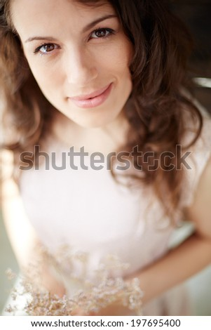 Sensual young woman with flowers looking at camera #197695400
