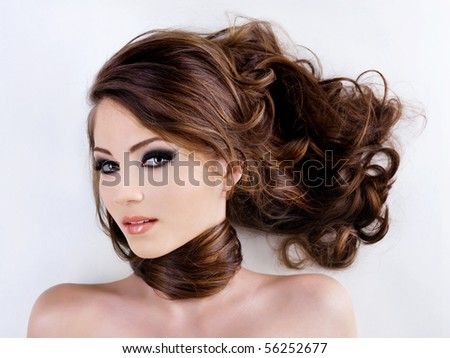 Sensuality and attractive young woman face with beauty hairs