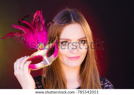 Sensuality celebrations people concept. Sensual lady holding carnival mask. Young woman has amazing and delicate make up. #785542051