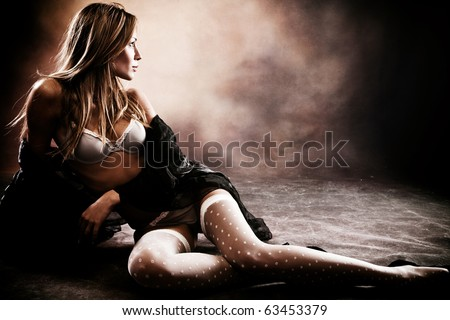 sensuall brunette woman in underwear, studio shot, dark background,