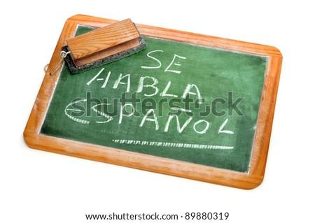 sentence Spanish is spoken written in spanish on a chalkboard