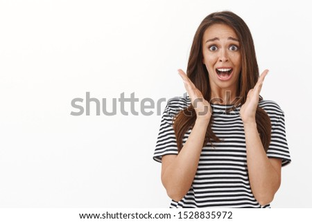 Sentimental and emotive young cute girl hear friend getting married, crying happily, panicking scream from happiness and surprise waving hands ambushed, standing white background amazed
