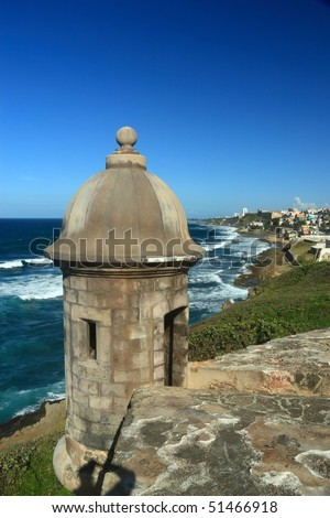 Sentry box overlooking the Atlantic Ocean at 'El Morro' (Castillo San Felipe del Morro) and the La Perla district of Old San Juan, Puerto Rico